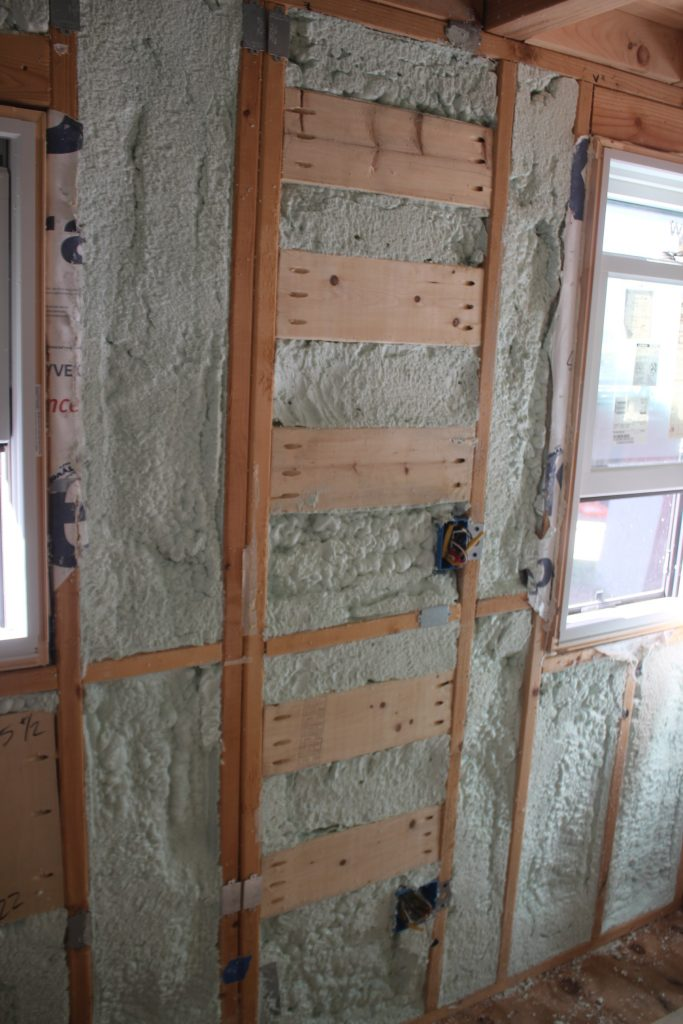 Wood blocking installed so we can securely mount ladder rungs on the wall