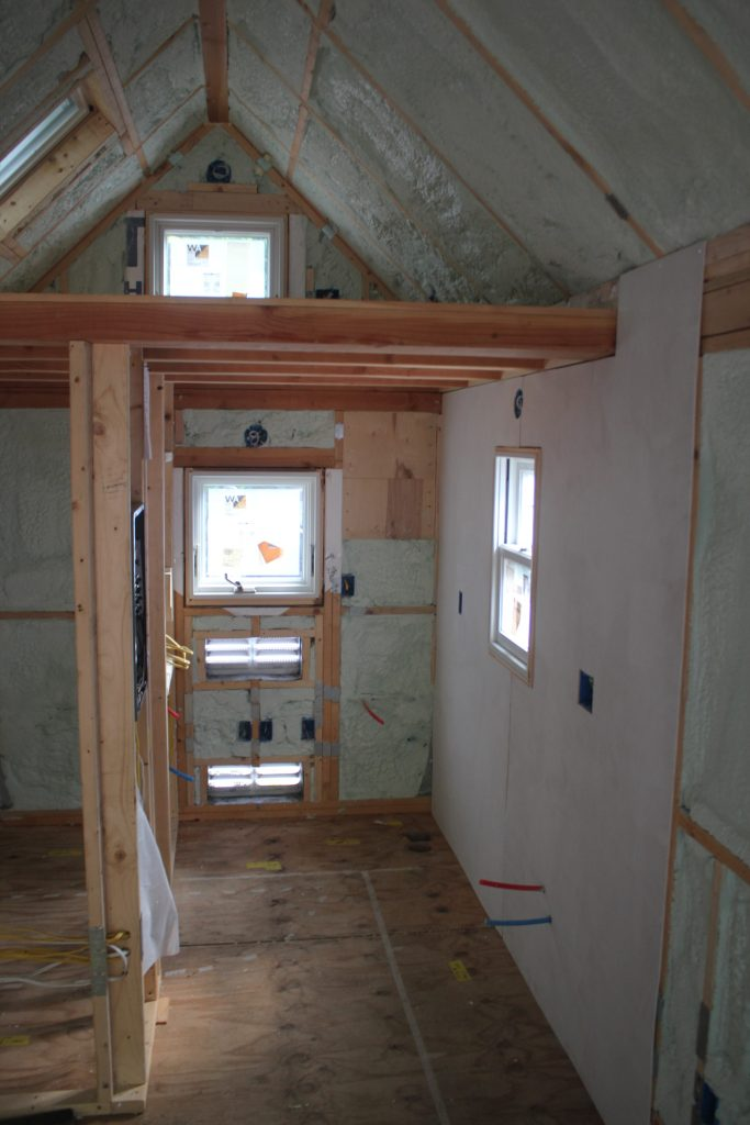 Interior wall plywood going up